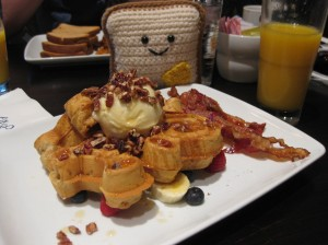 Mr. Toastee enjoying delicious Mickey Waffles wtih marscarpone cheese